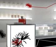 Layout interno di negozio monomarca abbigliamento e accessori di lusso 02