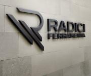 Radici-Insegna-muro-MockUp
