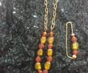 catena per pantaloni arancione-giallo